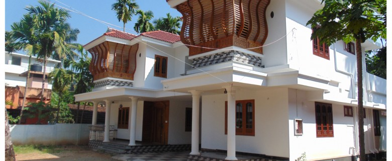 Low Cost Modern And Traditional Home Design In Kerala