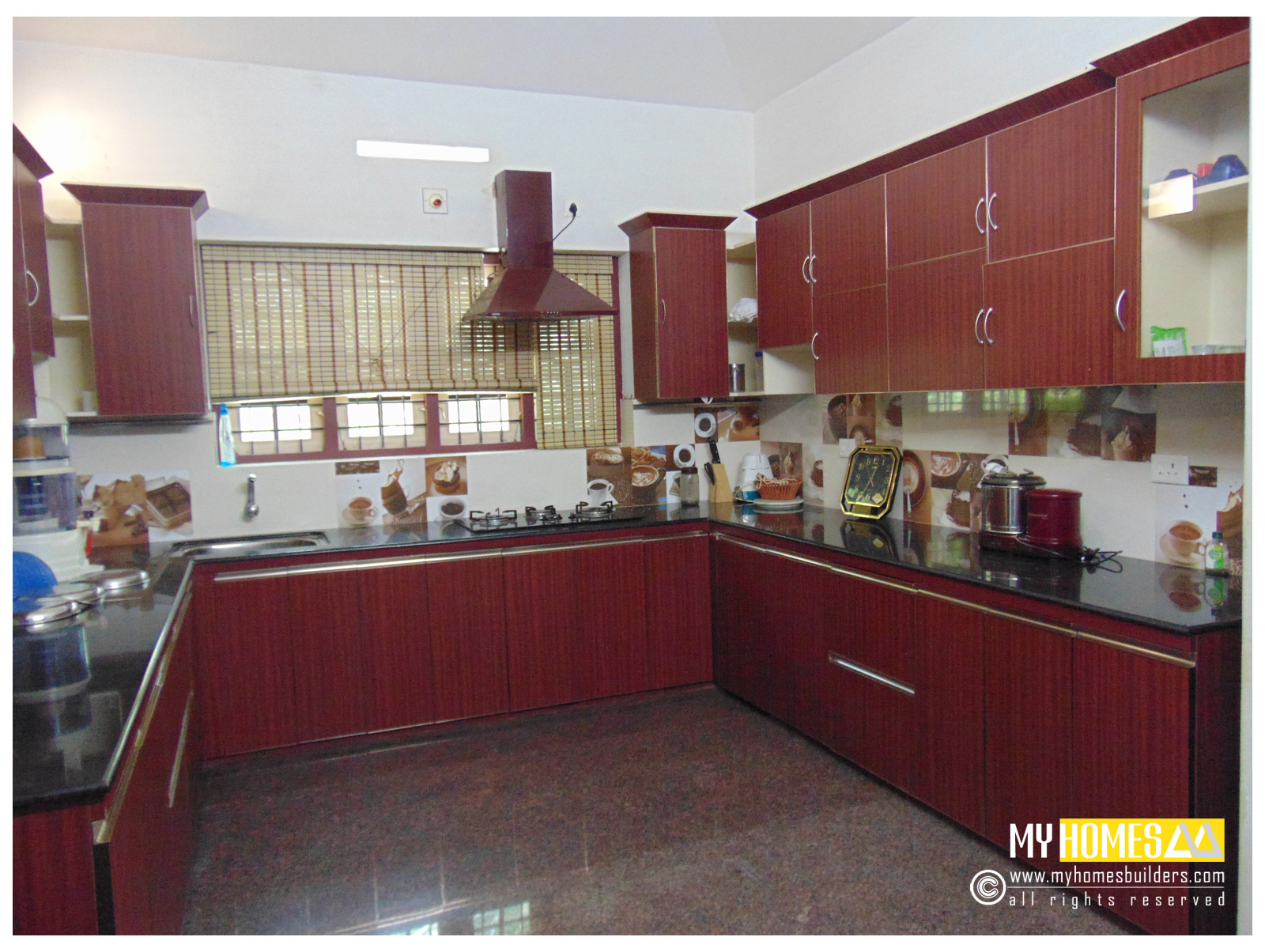 Budget house kerala home designers builder in thrissur india for Homey kitchen designs