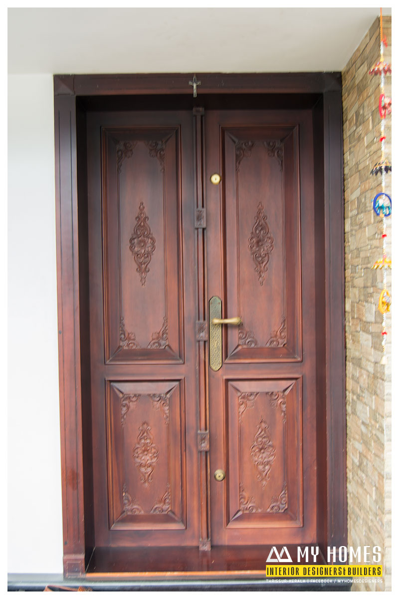 Delicate front wooden door designs kerala for Entry door designs for home
